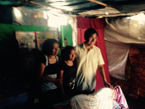 The family we visited in their tarp house